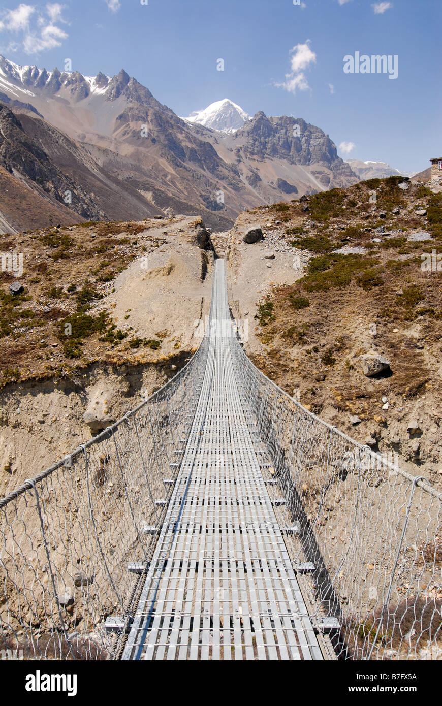 Wire bridge on the Annapurna circuit near Manag - Stock Image