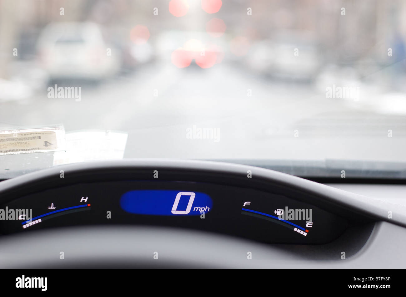 Closeup of Speedometer during Rush Hour Traffic - Stock Image