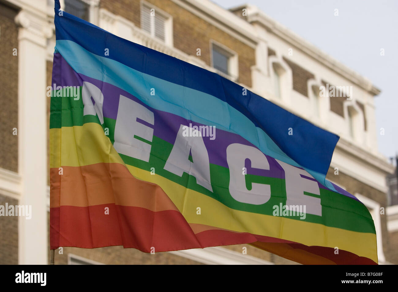 Peace flag fluttering in breeze in London at anti BBC rally in protest at the broadcaster's refusal to air chairty Stock Photo