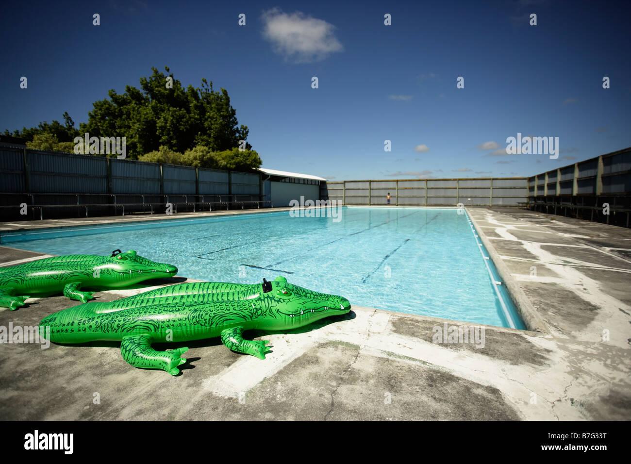 Inflatable crocodile at swimming pool - Stock Image
