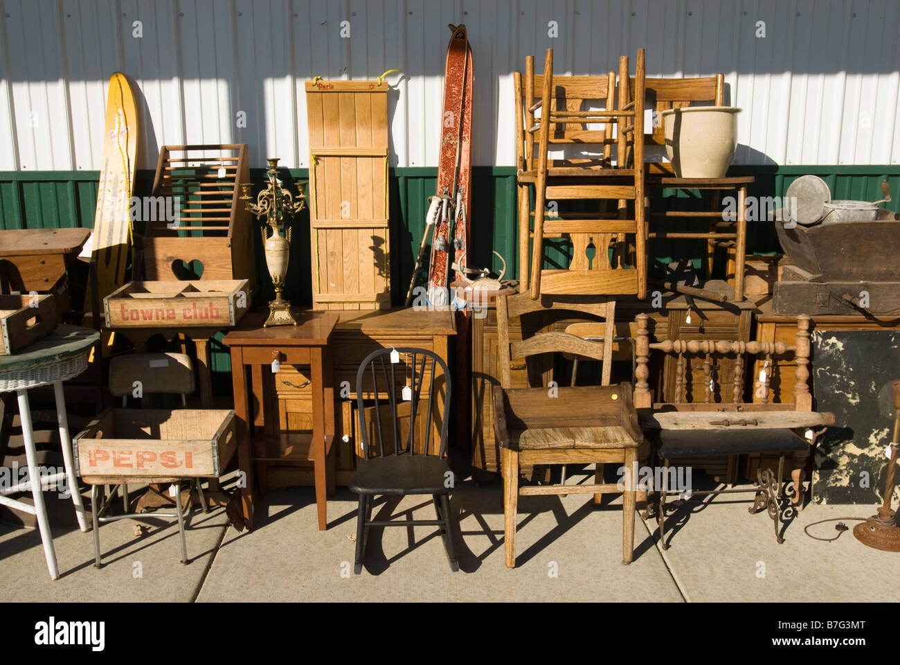 Old furniture for sale at an antique mall in Michigan, USA. Stock Photo