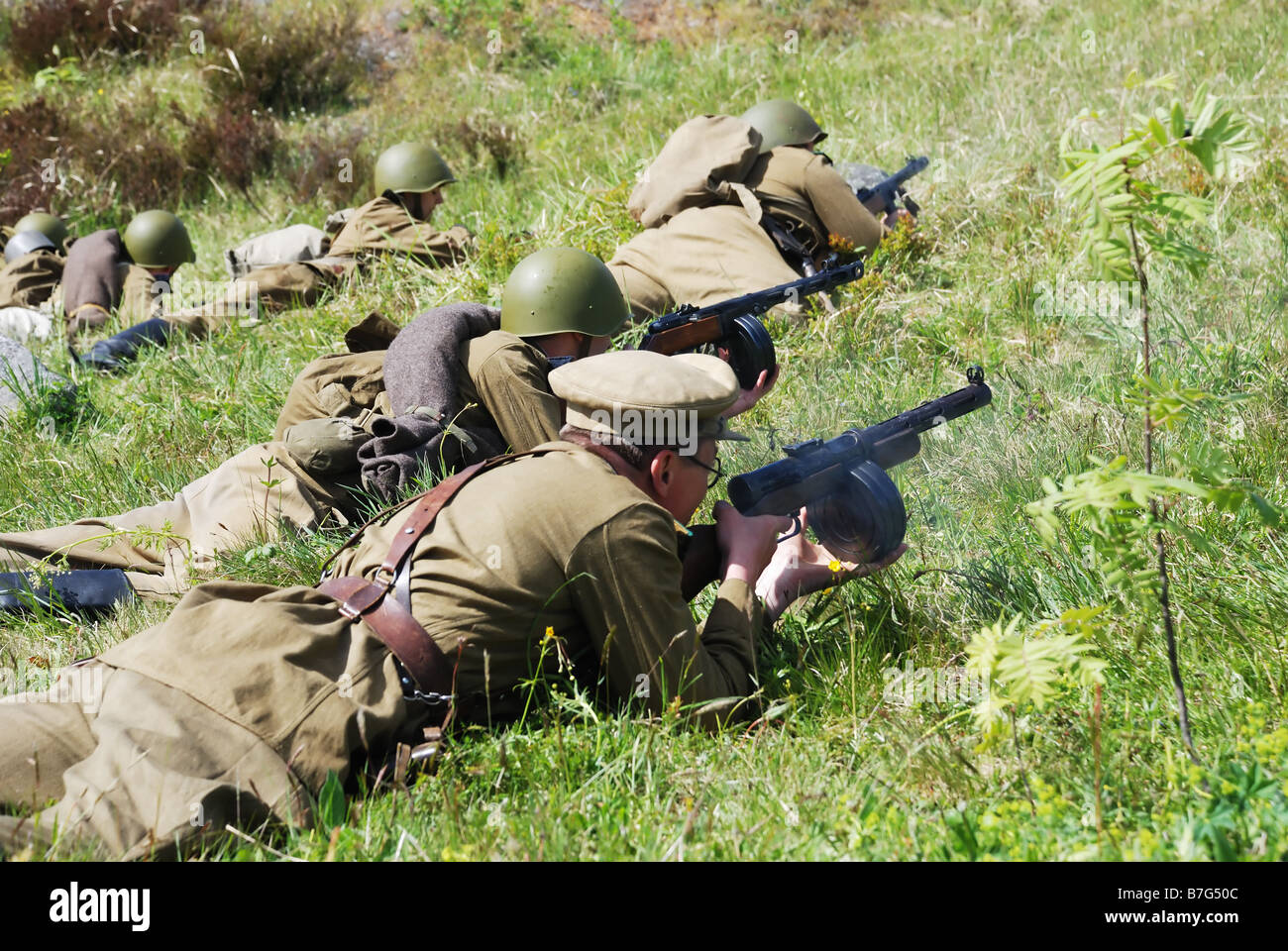 World War II, fancy, men in the uniforme of the soviet soldiers with a soviet flag, historical reconstruction of - Stock Image