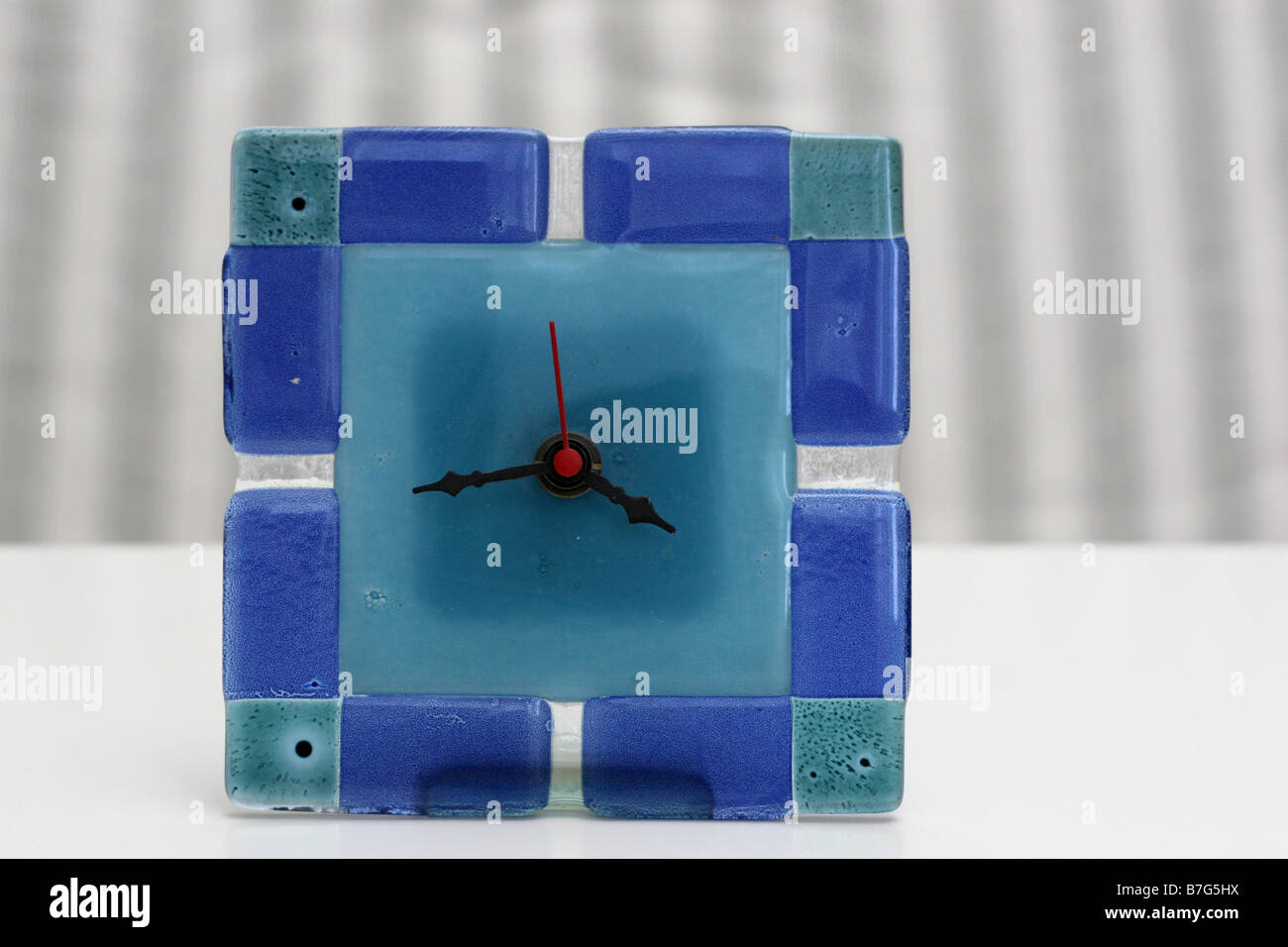 Blue analogue clock - Stock Image