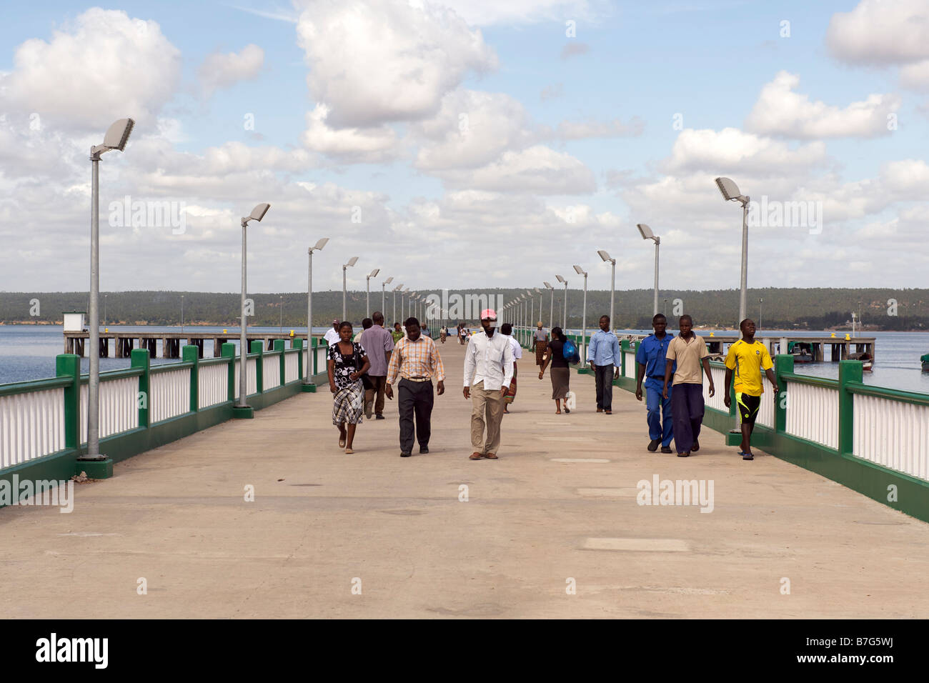 Pedestrians on the pier in the town of Inhambane in Mozambique. - Stock Image