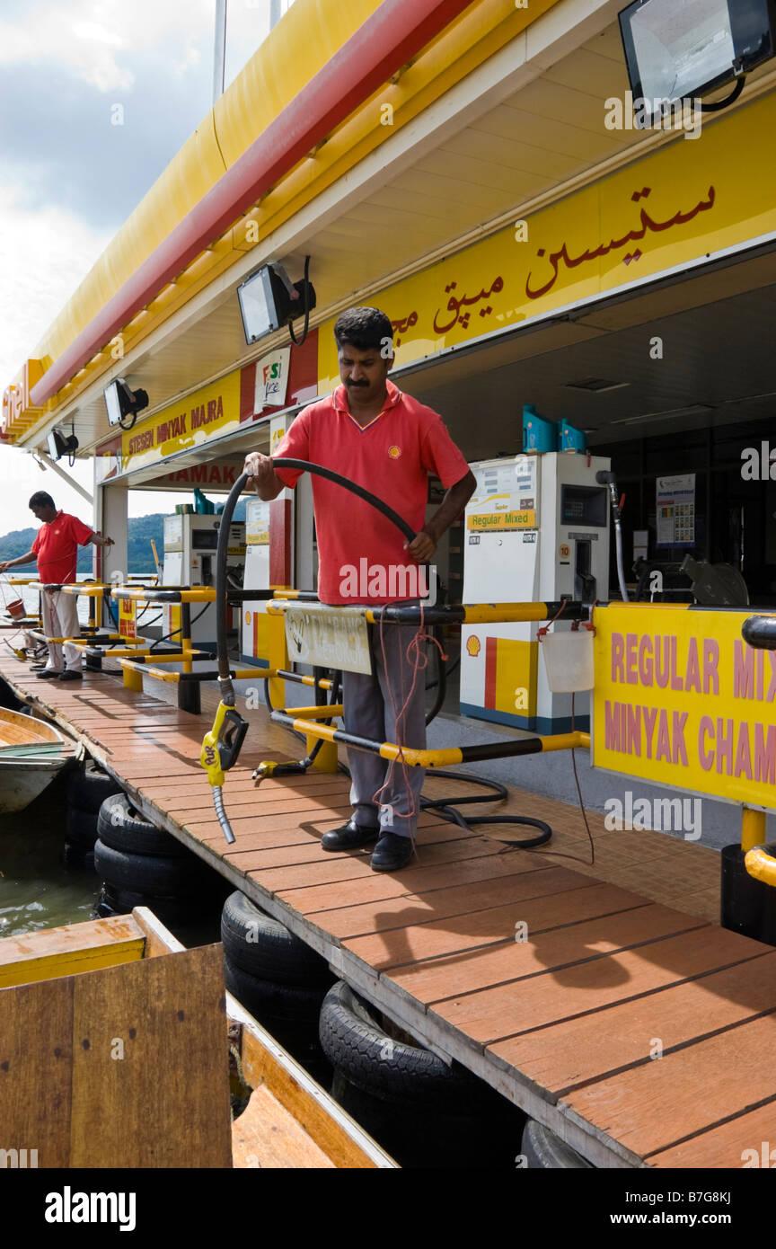 Petrol (gas) station on stilts on the River Brunei in Bandar Seri Begawan - Stock Image