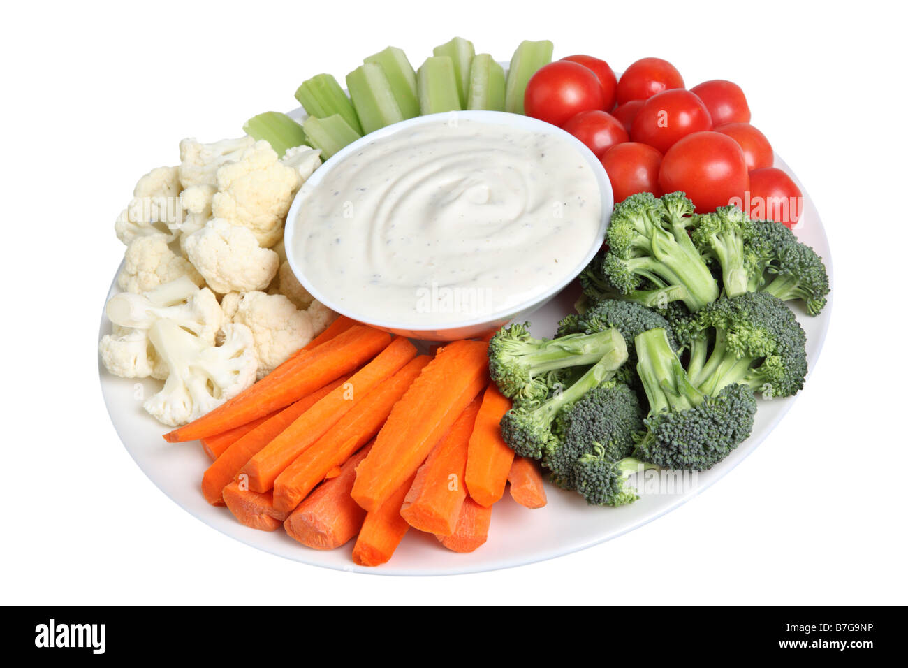 Vegetable tray with cauliflower celery tomatoes broccoli carrot sticks and ranch dip - Stock Image