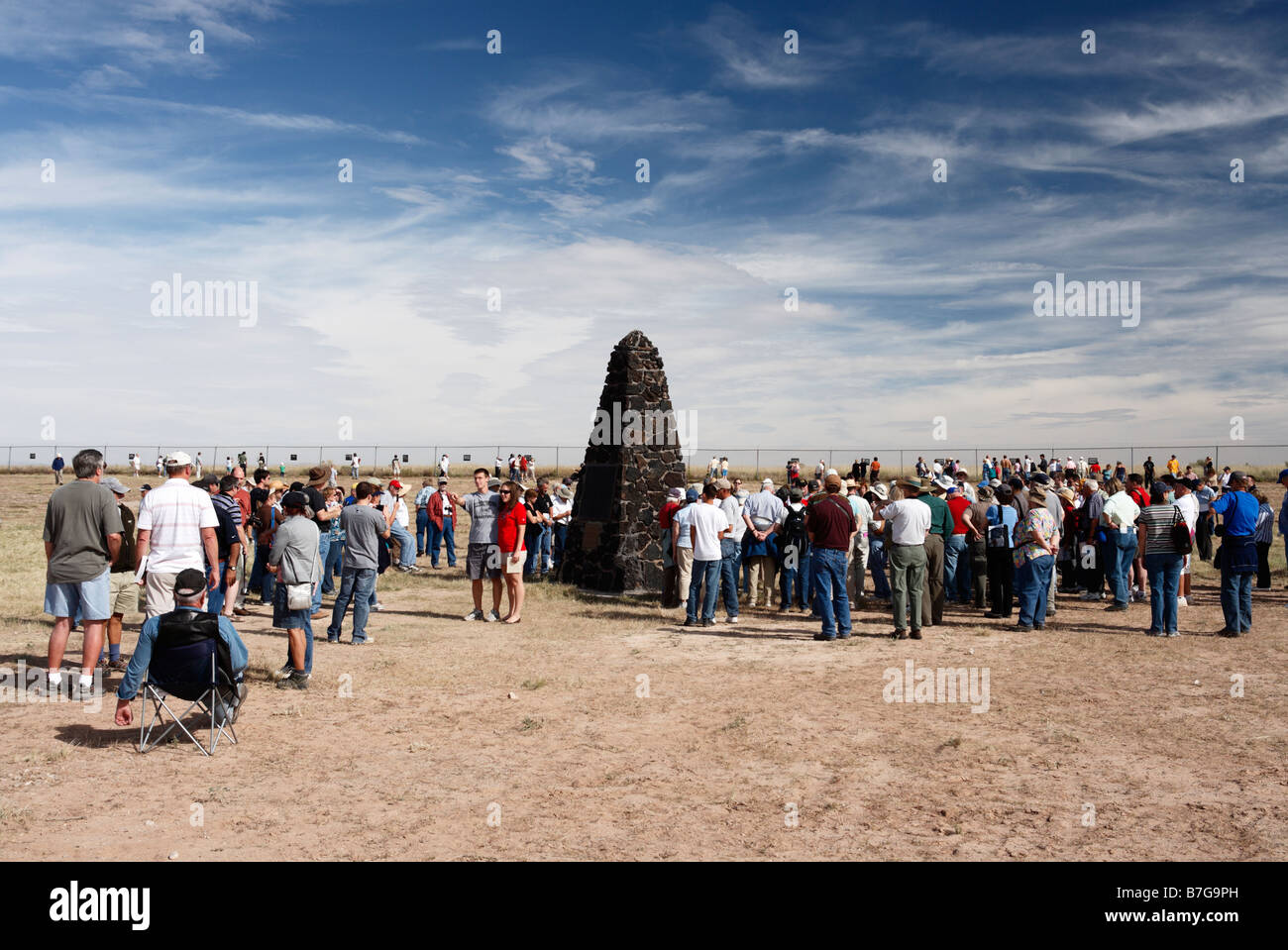 Sightseers gather around the obelisk at Trinity Site, New Mexico, marking the site of the world's first atomic - Stock Image