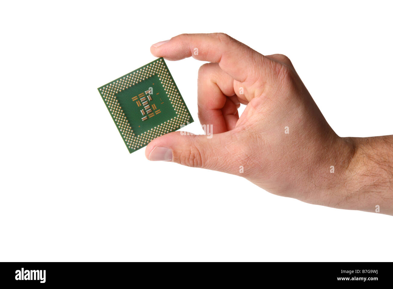 Hand holds computer CPU processor chip cut out on white background - Stock Image