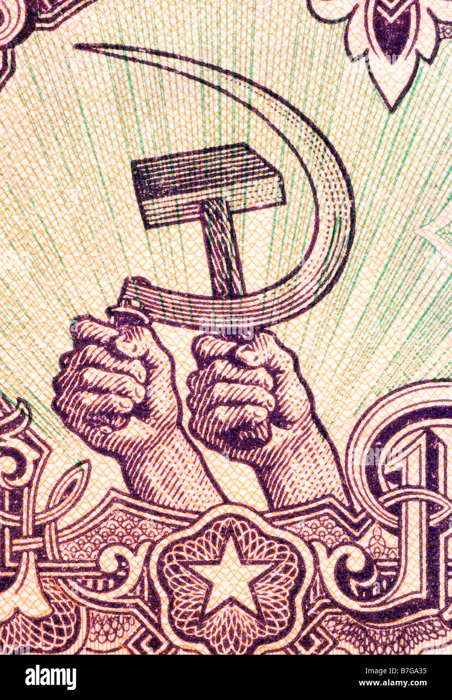 Hands holding hammer and sickle - Stock Image