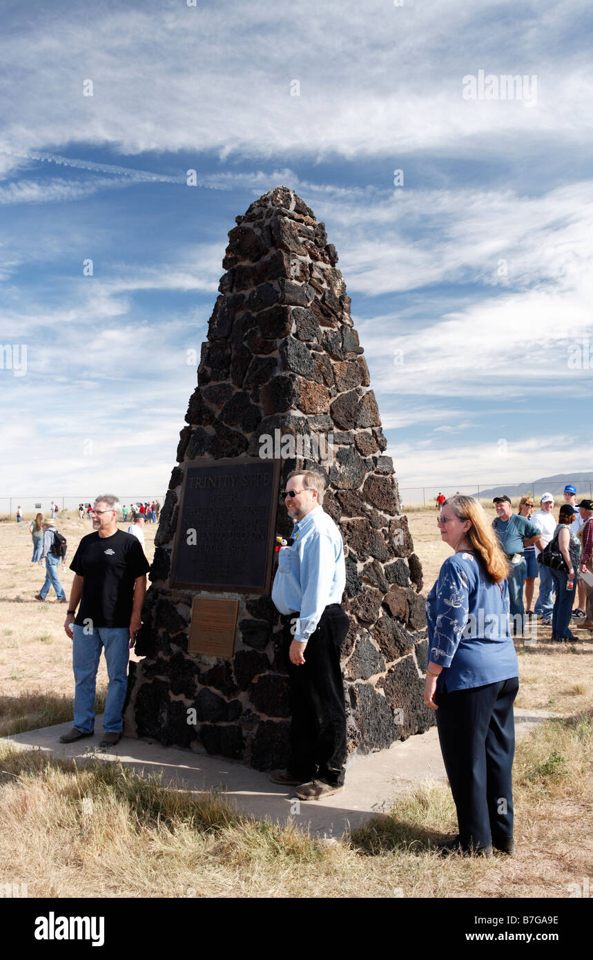 Sightseers pose for pictures around the obelisk at Trinity Site, NM marking the site of the world's first atomic - Stock Image