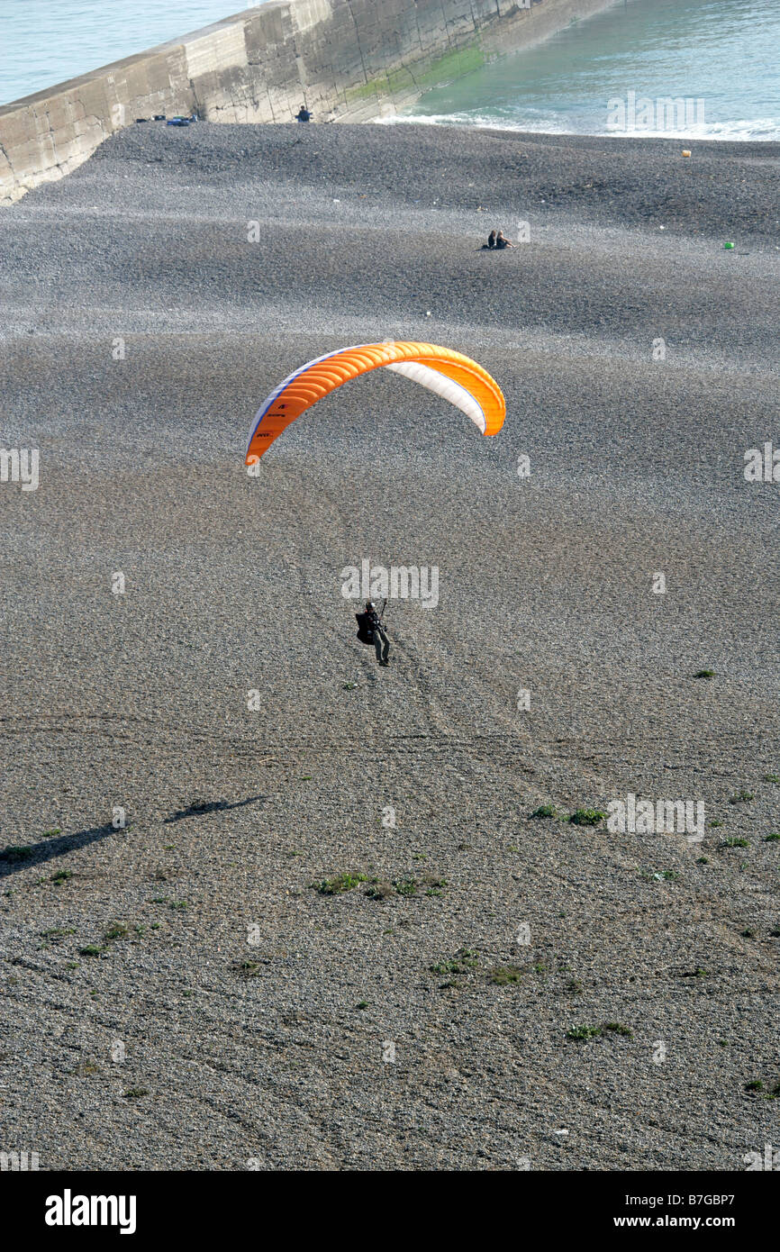 Paraglider Landing on Newhaven Beach from Castle Hill Chalk Cliffs, Newhaven, East Sussex, UK. Stock Photo