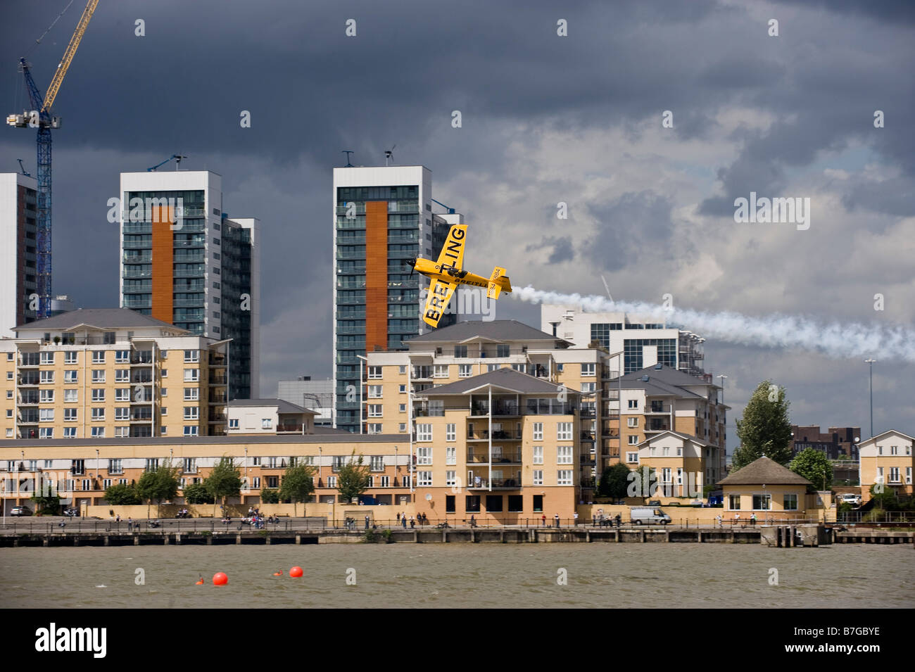 Light race plane flying through air filled pylons at Red Bull air race London - Stock Image