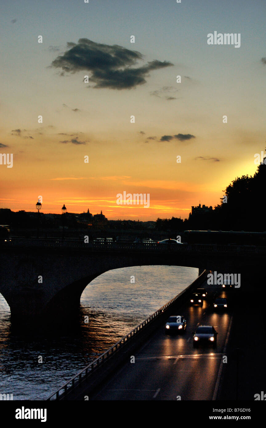 View of the Pont Louis Philippe at sunset taken from the Pont Marie in Paris - Stock Image