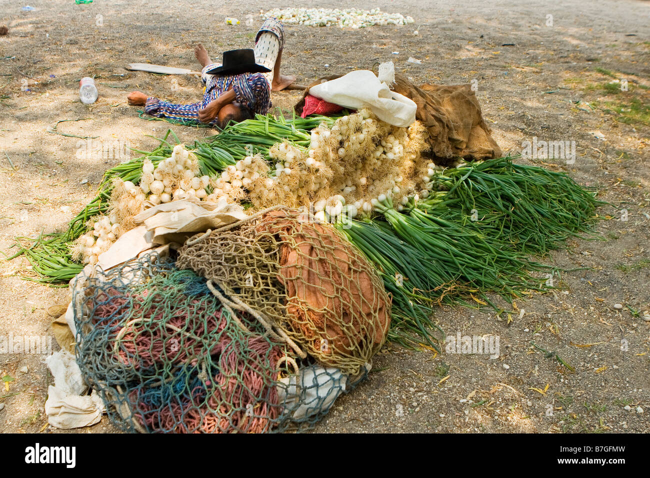 Indigenous farmer takes a break after a long day of harvesting green onions Santiago Atitlan, Lake Atitlan Guatemala - Stock Image