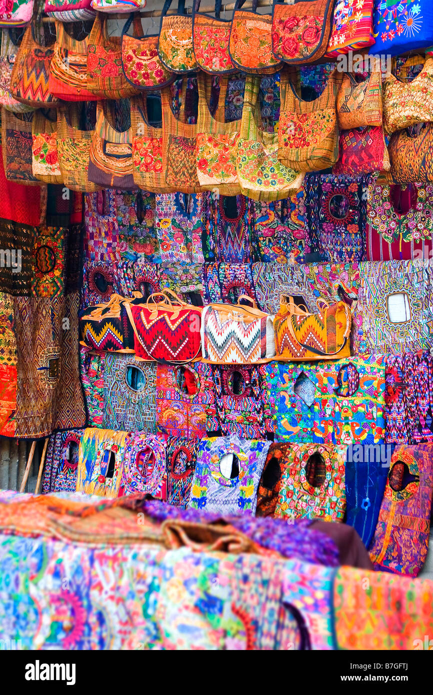 Colorful handmade Mayan textiles for sale at market in Santiago Atitlan Guatemala - Stock Image
