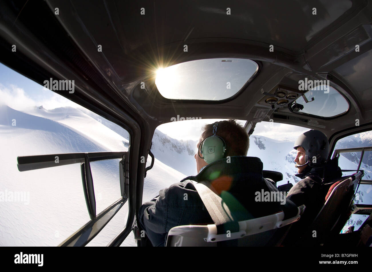 Snowy mountain peak as seen through the cockpit window of a helicopter Near Whistler British Columbia Canada - Stock Image