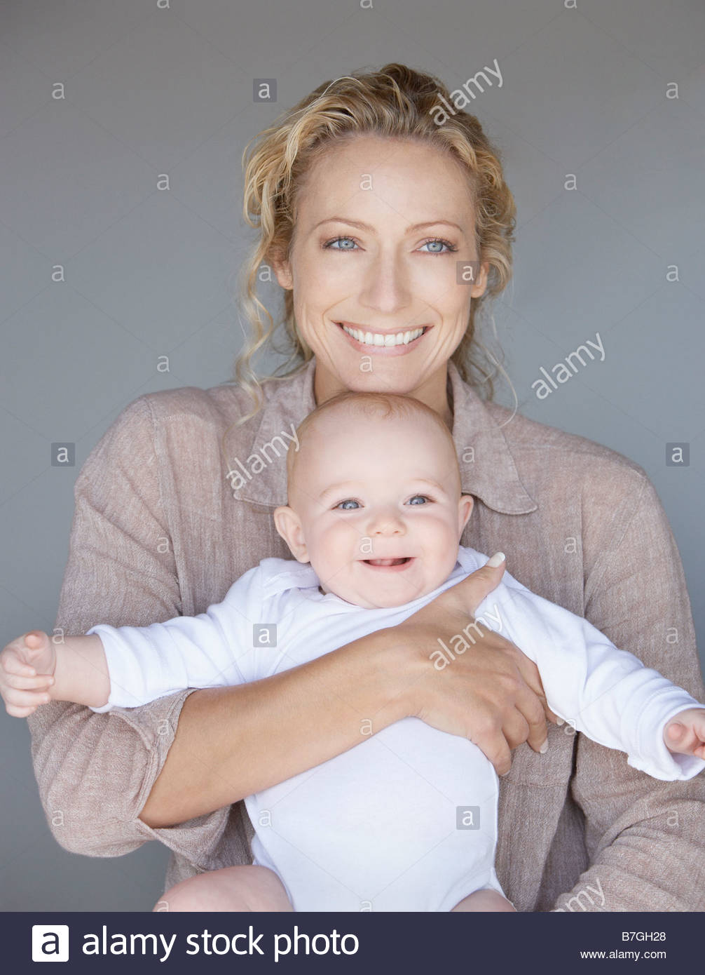 '30-35 Years,30s,6-9 Months,Baby Boys,Affection,Beginnings,Color Image,Cuddling,Day,Embracing,Family,Family - Stock Image