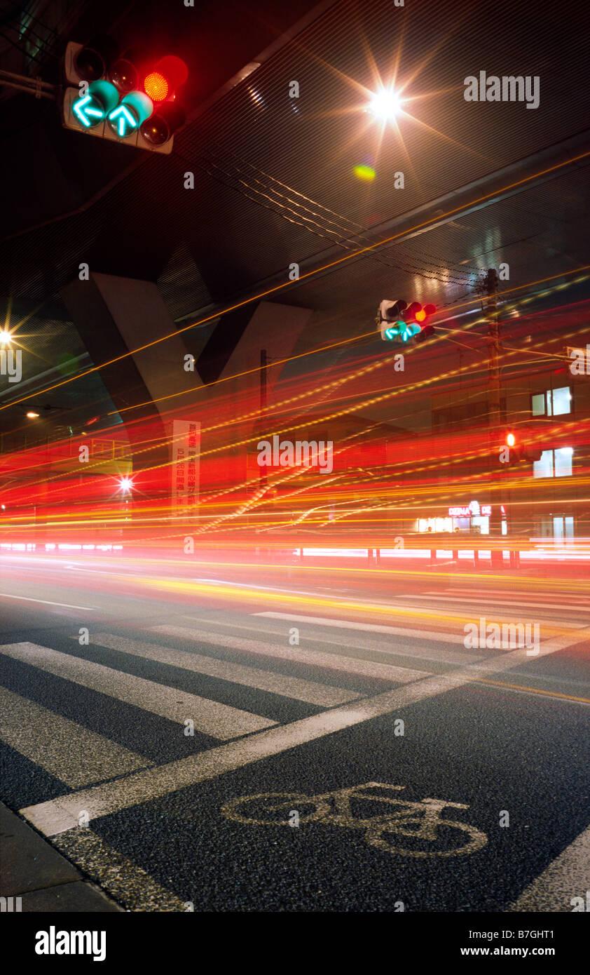 Night time traffic in Yono (part of the Tokyo/Yokohama conurbation) in the Japanese prefecture of Saitama. - Stock Image