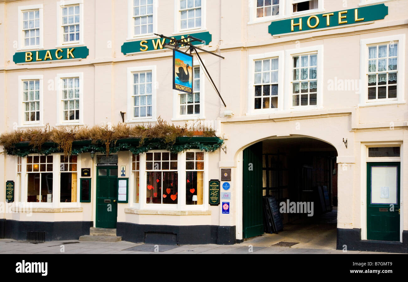 The Black Swan Hotel a Wadworth inn in the typical English market town of Devizes Wiltshire England UK - Stock Image