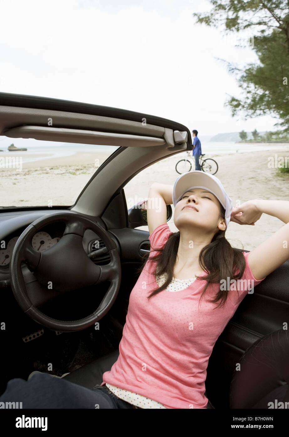 A woman in a convertible - Stock Image