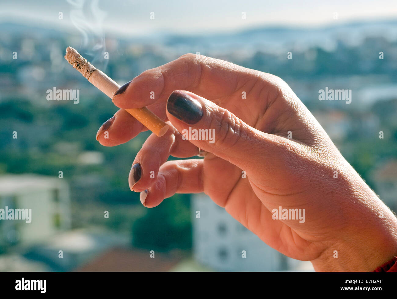 Female hand with cigarette - Stock Image