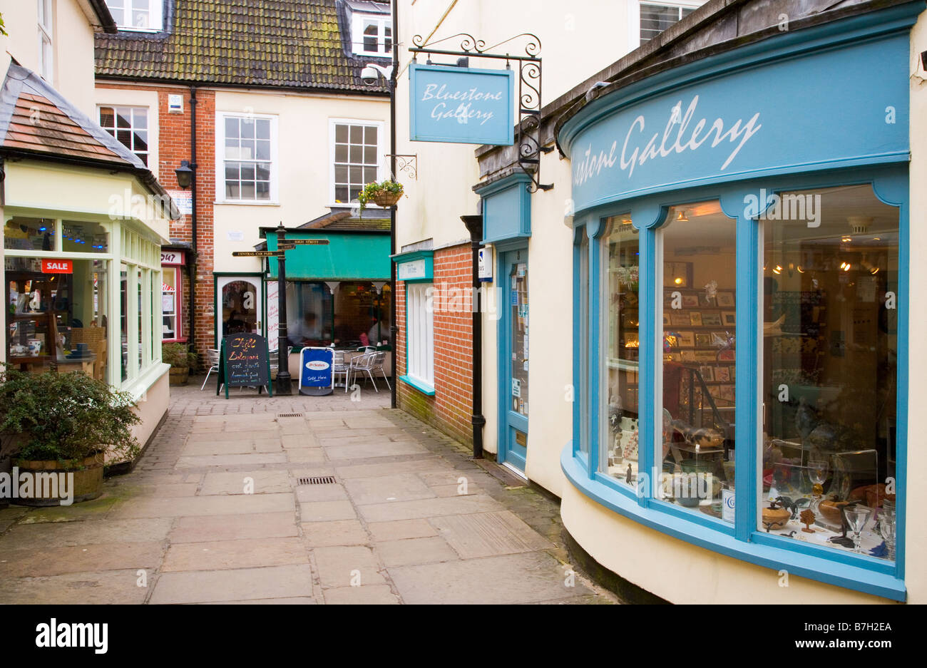Old Swan Yard an alleyway of boutique shops and cafes in the typical English market town of Devizes Wiltshire England - Stock Image