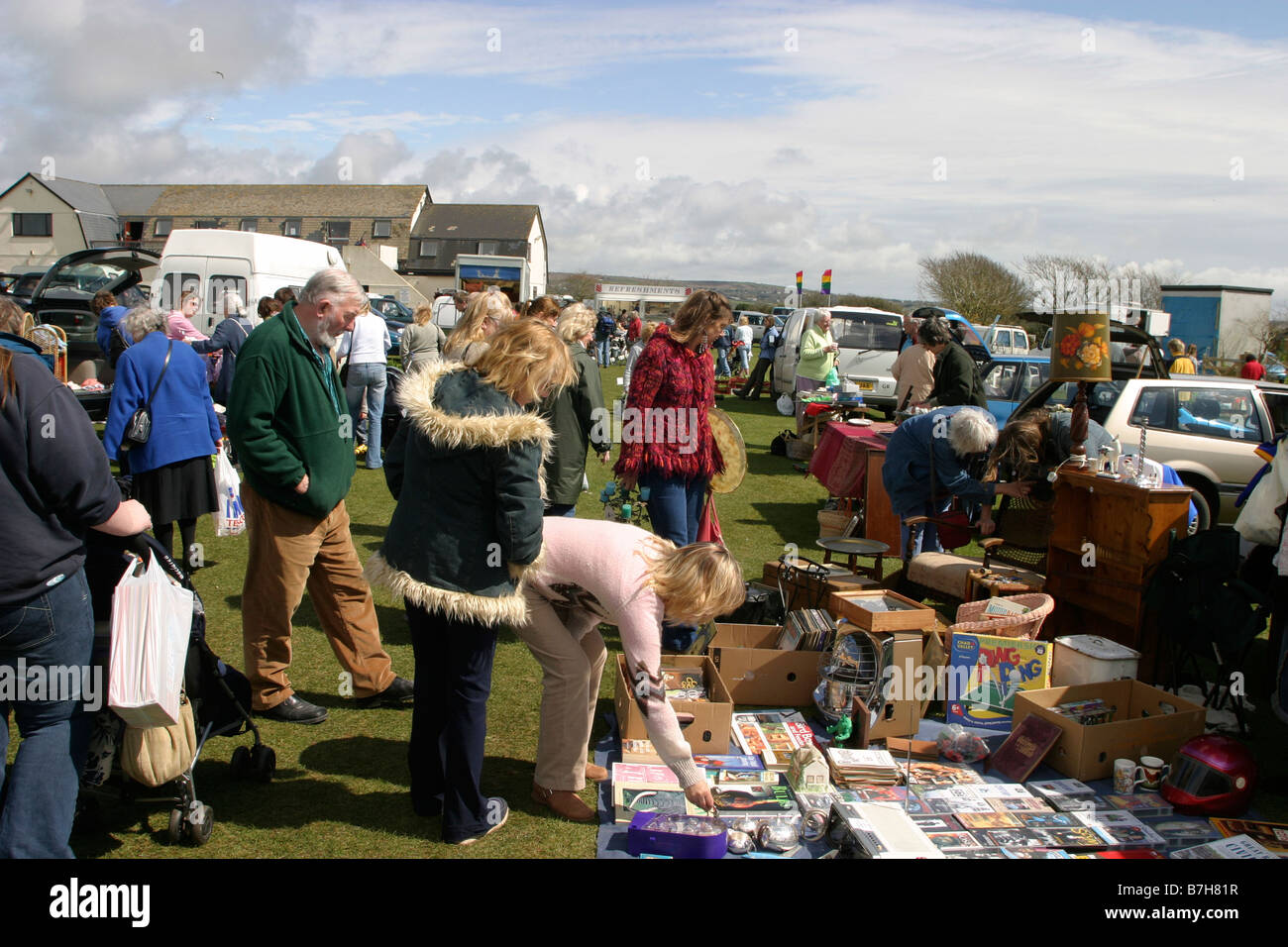 People peruse at a car boot sale - Stock Image