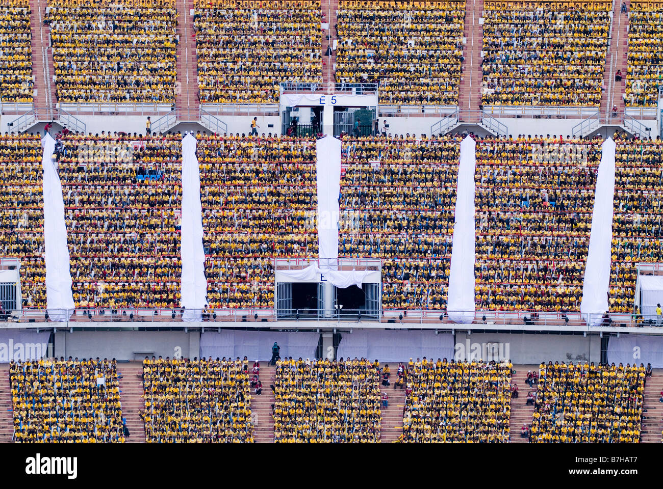 Crowds of Young Thais in Rajamangala Stadium watch the world student games in Bangkok. - Stock Image