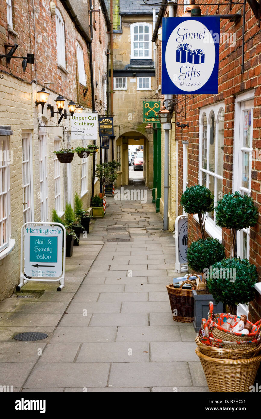 Boutique shops in a side alley called The Ginnel in the typical English market town of Devizes Wiltshire England - Stock Image