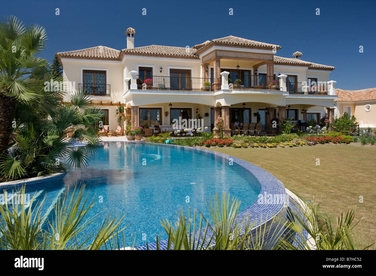 Raised Swimming Pool In Garden Of Large New Detached Holiday Villa On  Urbanization In Southern Spain
