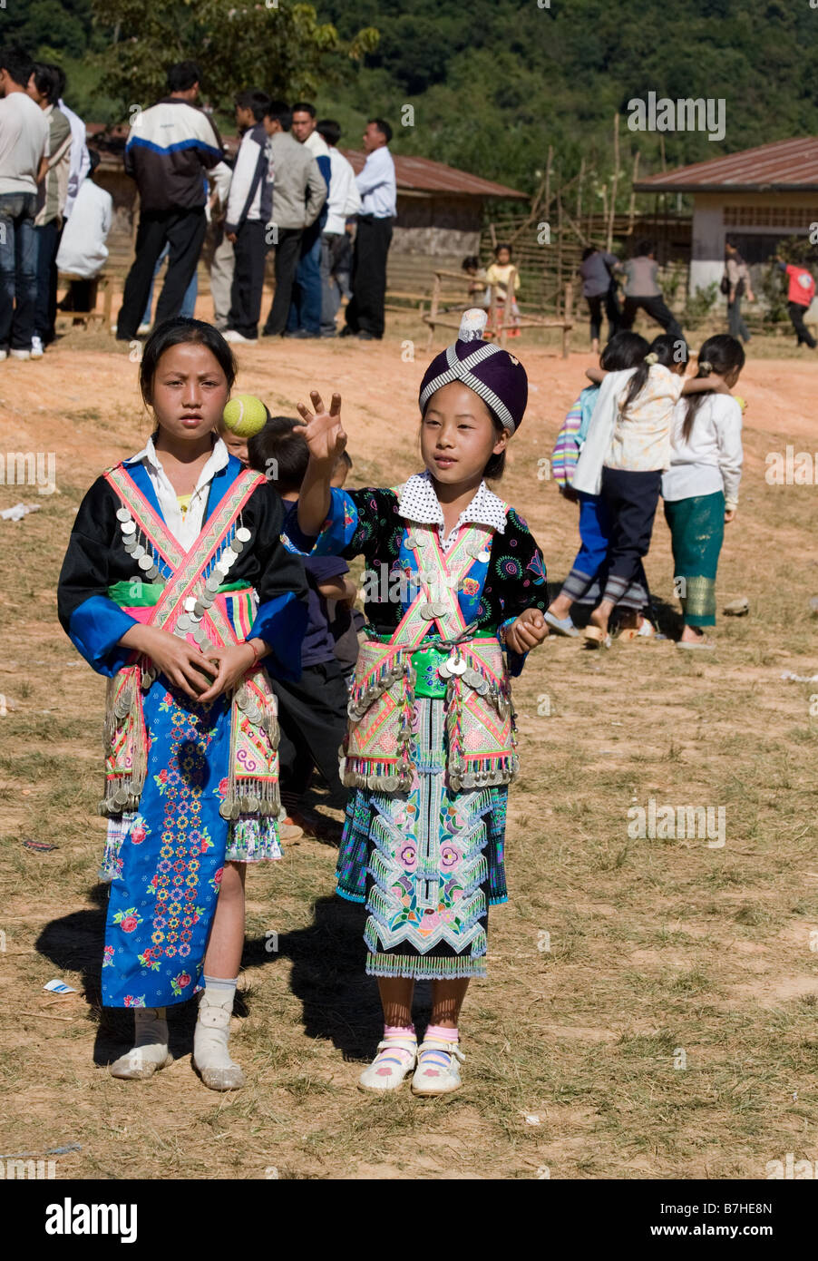 Two young Hmong girls in traditional costume at a Hmong New Year