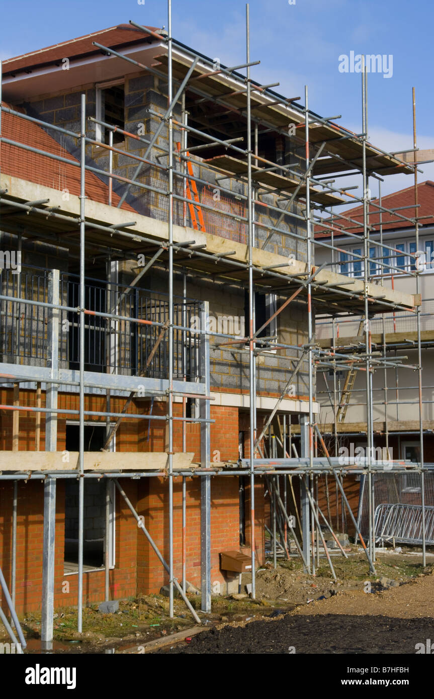 Houses Under Construction Building Site scaffold scaffolding poles - Stock Image