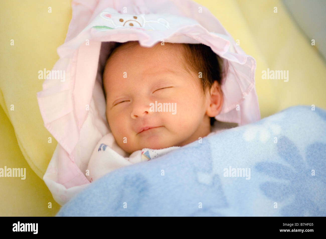 176b806a7422 Portrait of a 1 week old newborn baby girl sleeping peacefully and ...