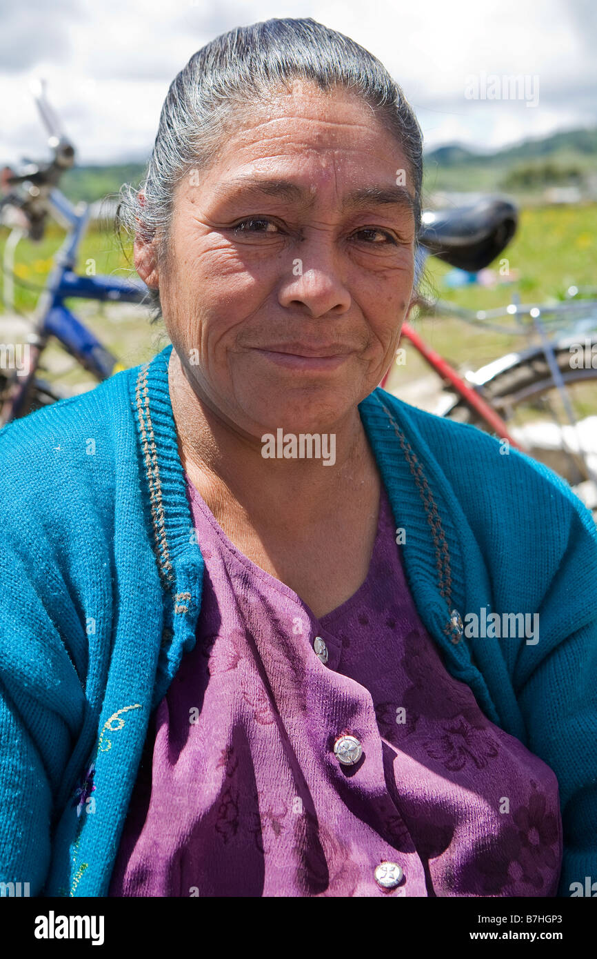 Guatemalan woman poses outside a church in San Nicolas, Western Highlands, Guatemala - Stock Image