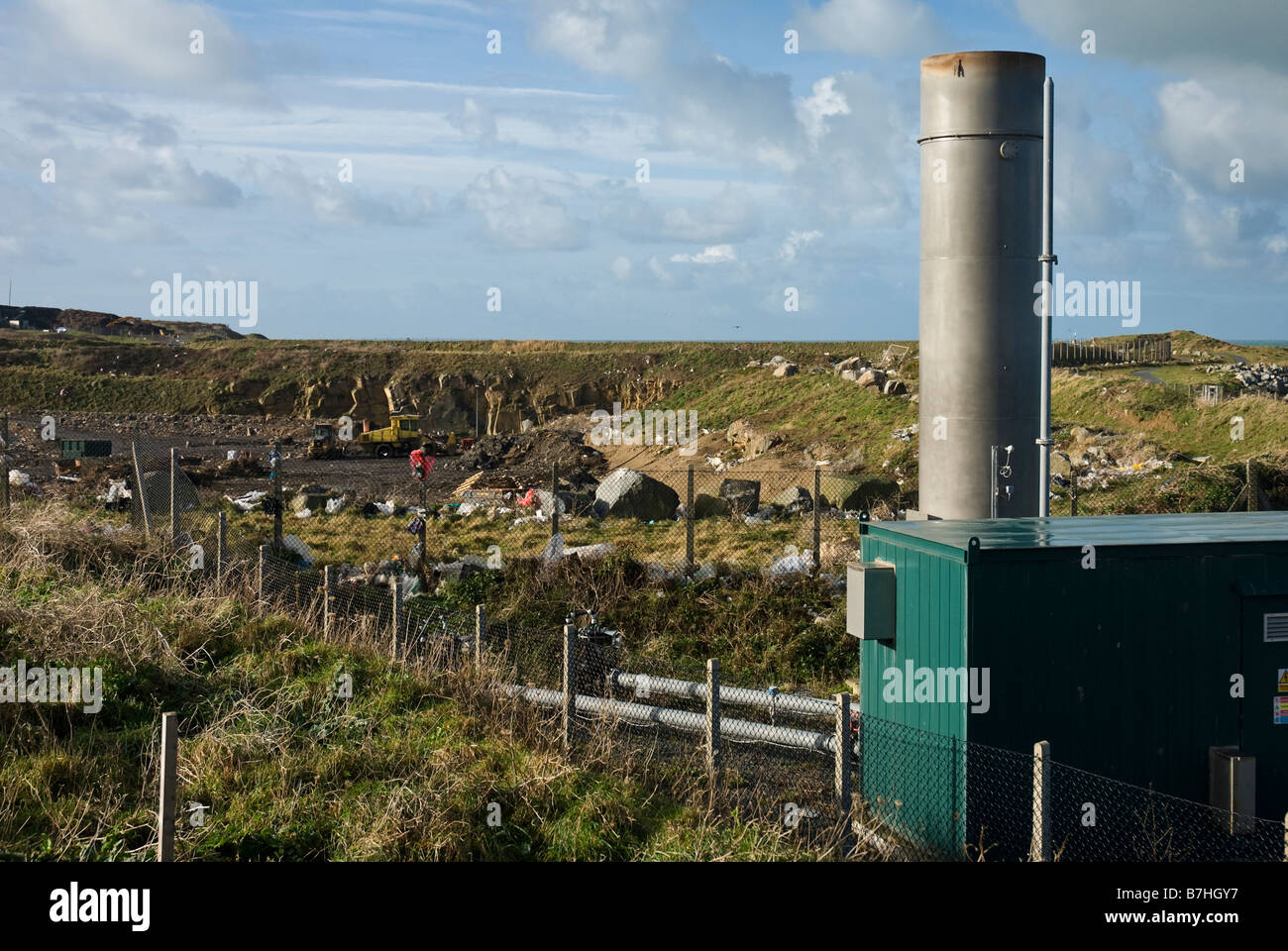 Flare stack at landfill site for burning off methane - Stock Image