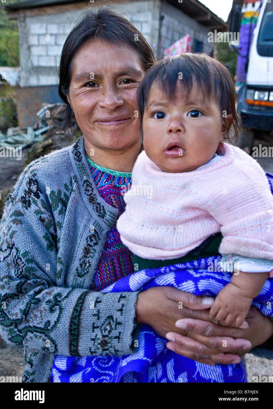 Mother holds her daughter in a village outside Todos Santos Cuchumatan Western Highlands Guatemala - Stock Image