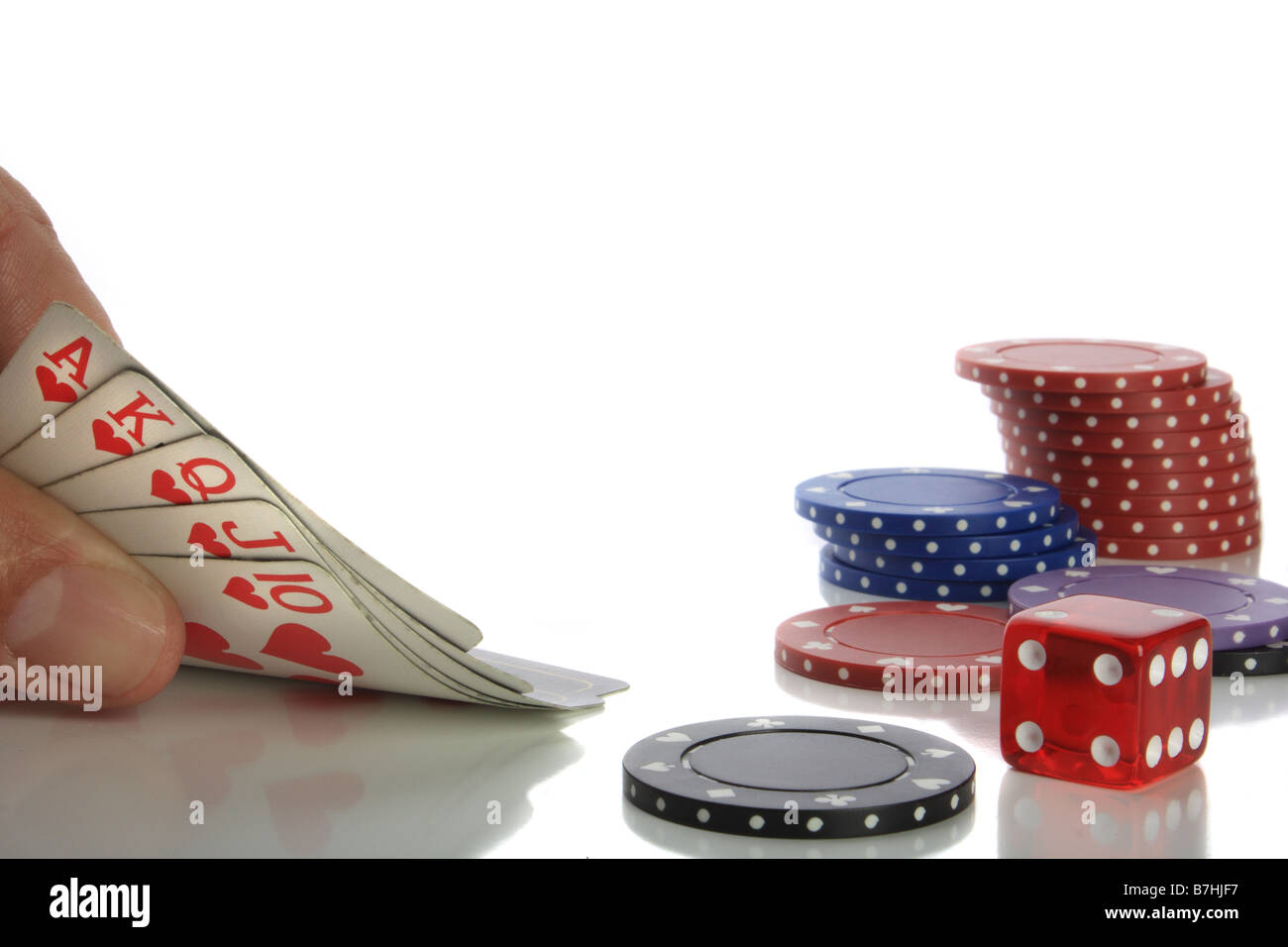 Poker cards and chips reflected on table - Stock Image