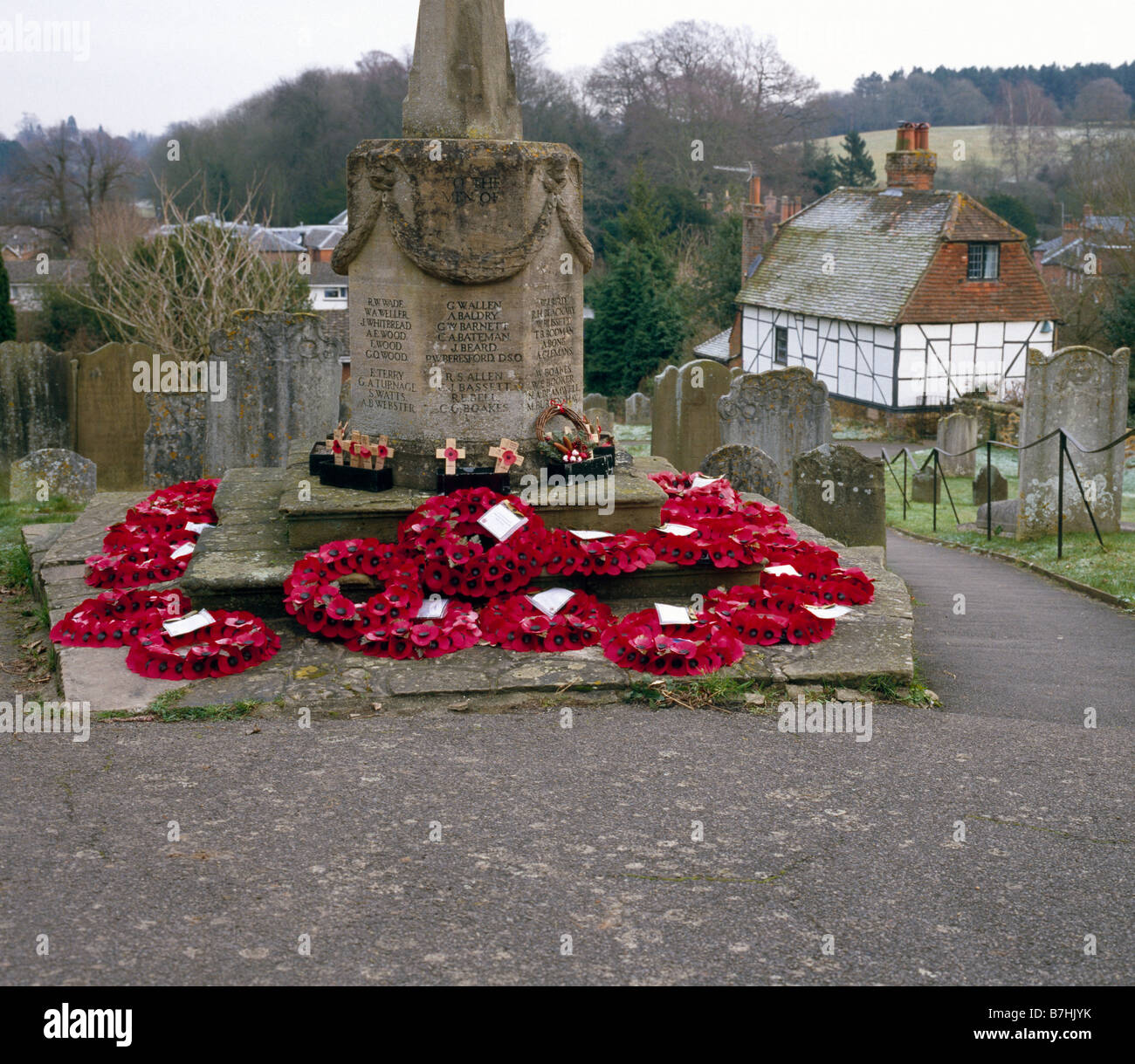St Marys Church war memorial with Remembrance Day poppies. Westerham, Kent, England, UK. - Stock Image