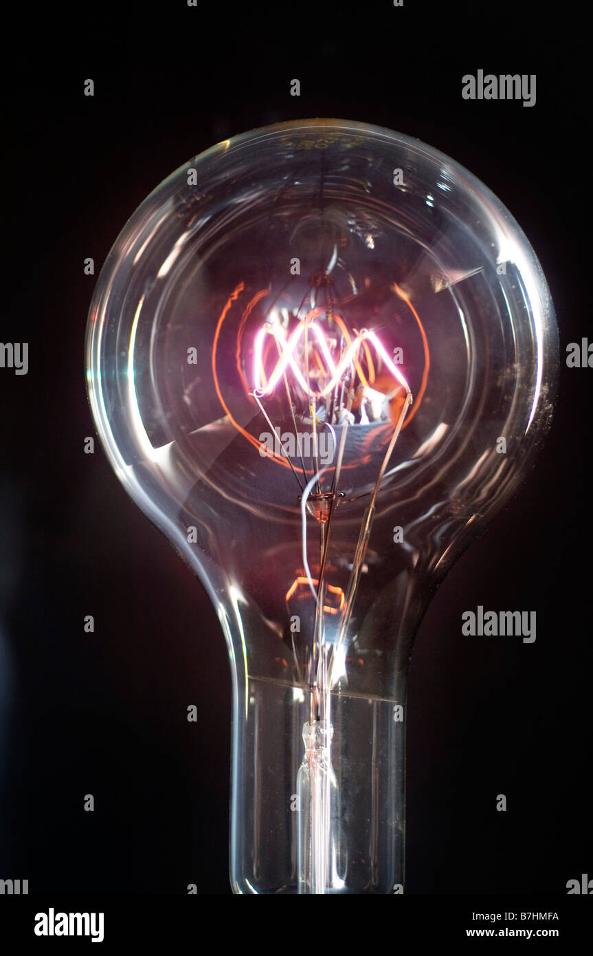 A clear 1000 watt OSRAM Incandescent lightbulb manufactured in the 1930s - Stock Image