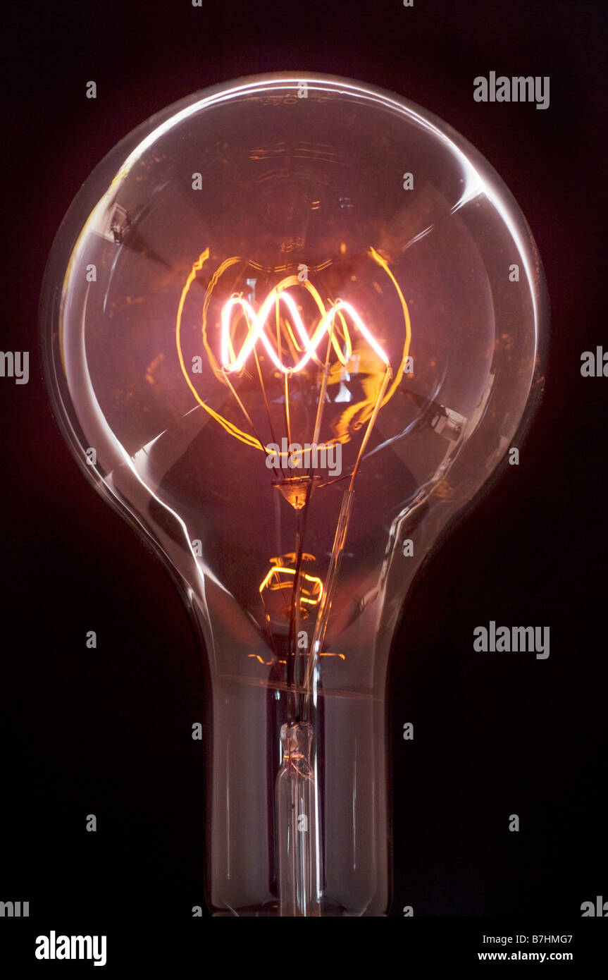 A clear 1000 watt OSRAM Incandescent lightbulb manufactured in the 1930s and still working. - Stock Image