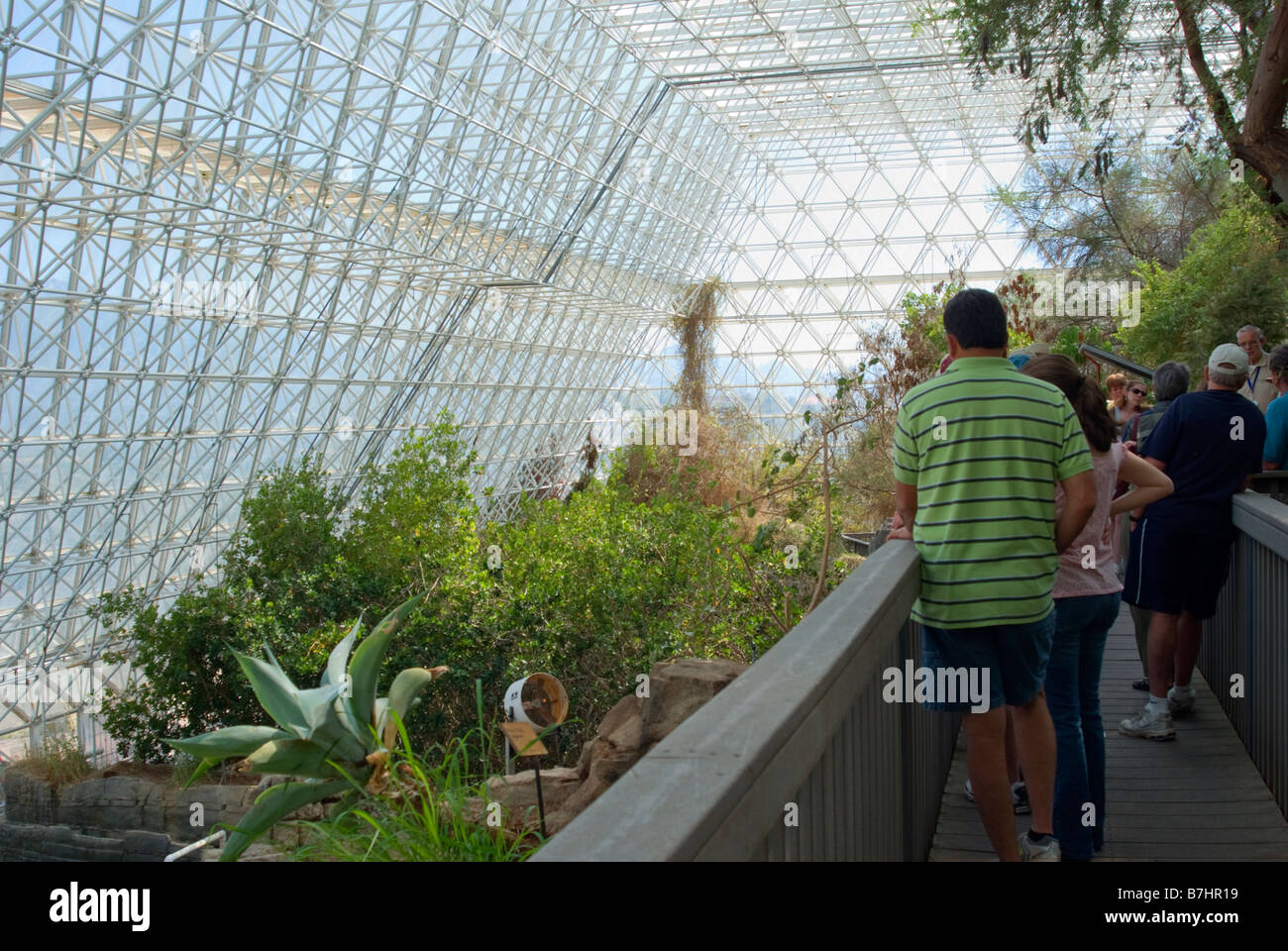 USA, Arizona, Oracle, Biosphere 2, Ocean biome visitors listen to guide habitat living quarters and glass enclosed - Stock Image