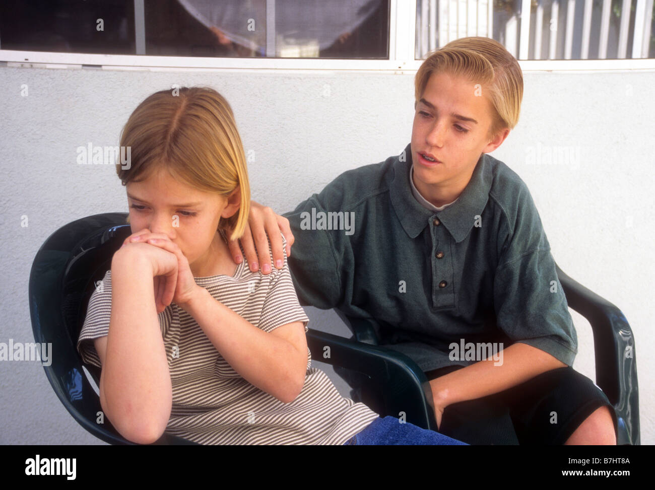 young boy comforts sad girl sibling family love concern support