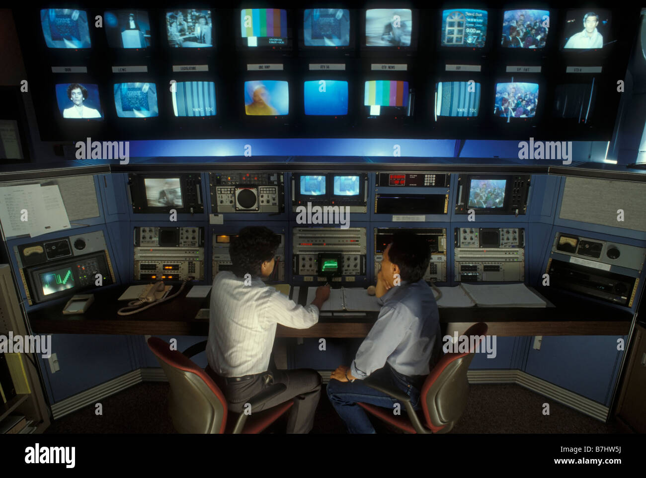 TV technecians at work in studio at television station