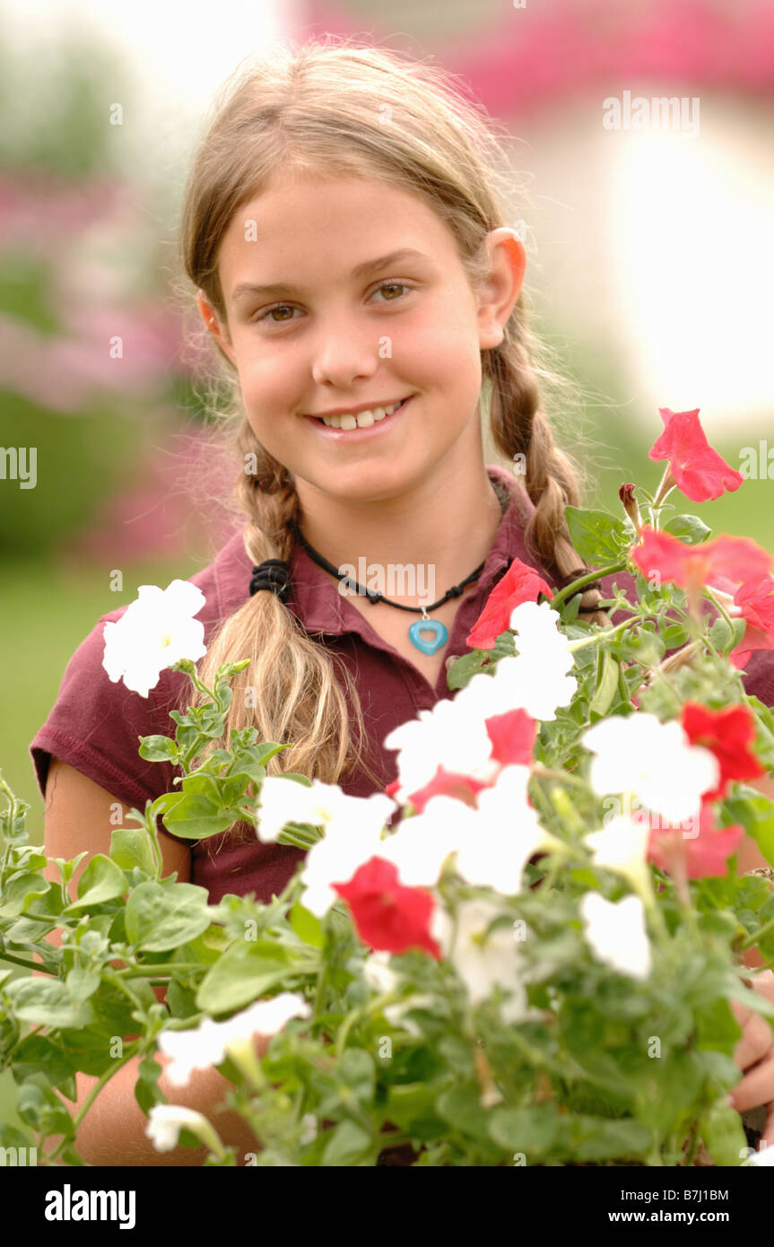Young girl holding flowers, Regina, Saskatchewan Stock Photo