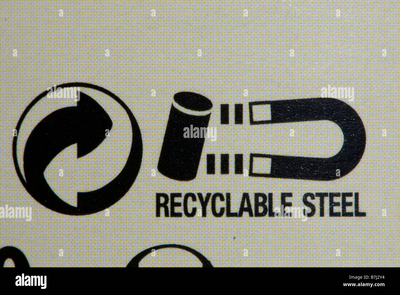Metal recycling symbol on label - Stock Image