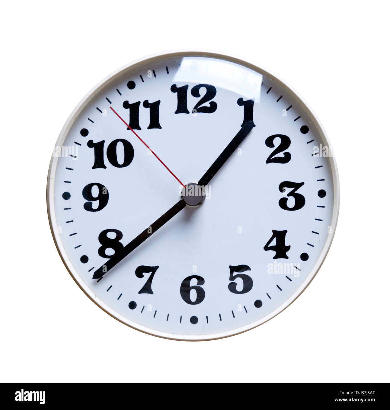 Wall clock on isolated white background - Stock Image