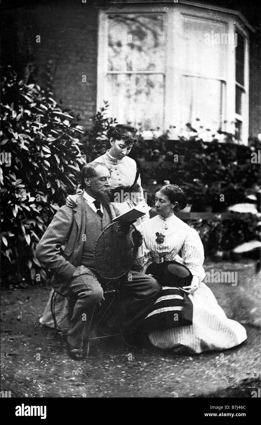 Charles Dickens Reading To His Daughters Mamey and Katey in the garden of his house at Gads Hill Kent in 1866 - Stock Image