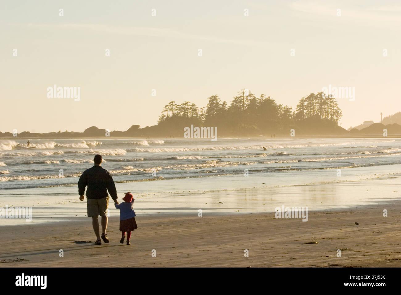 Father &  daughter walk along beach, Chesterman Beach near Tofino, Vancouver Island, British Columbia, Canada Stock Photo