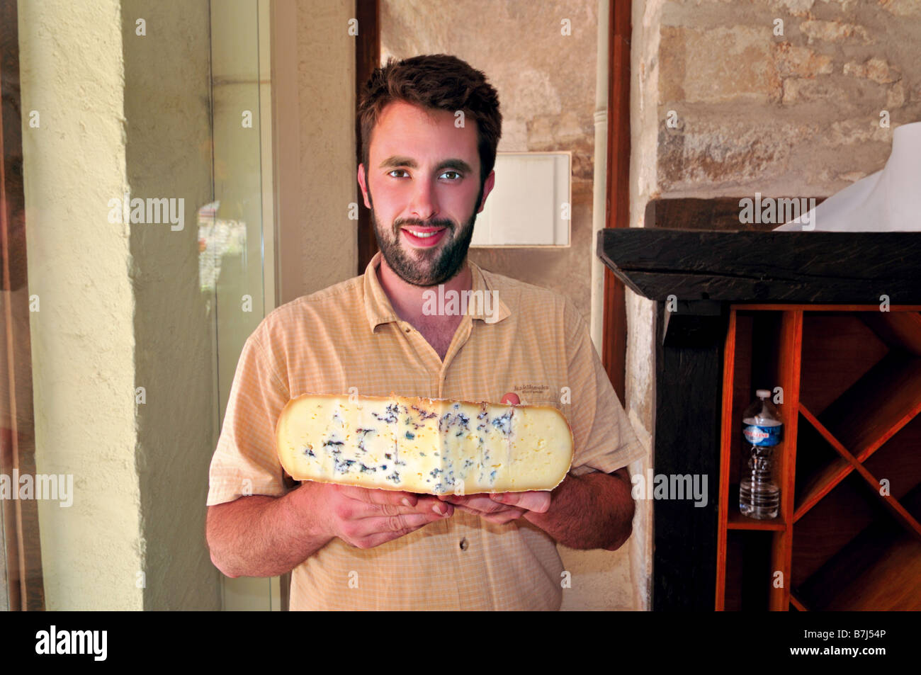 Julien with typical chees from the Pyrenees in the Fromagerie Rocamadour - Stock Image