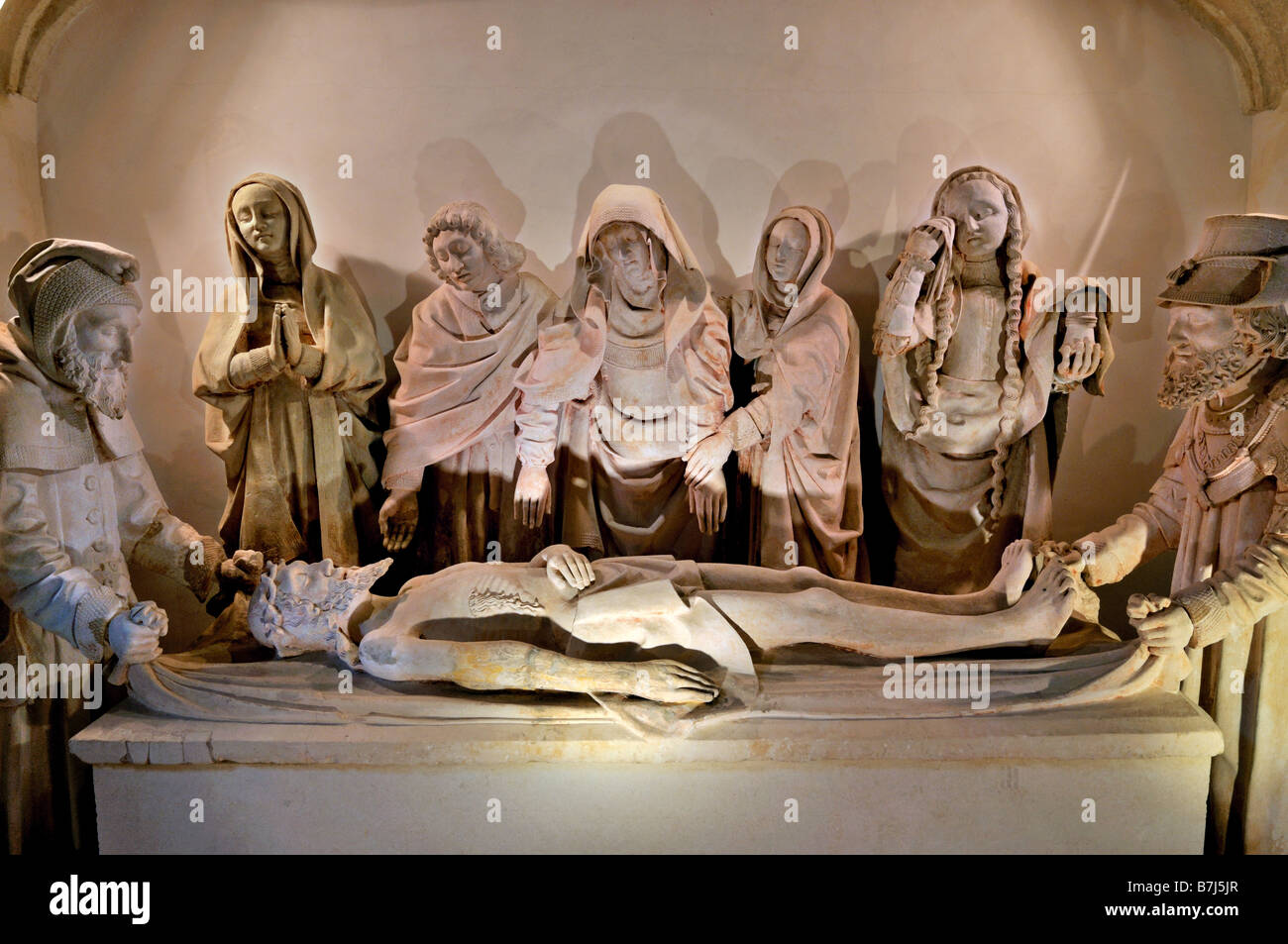 Medieval Entombment scenery of Christ in the cloister of Monastary St. Pierre in Carennac, Dordogne Valley, France - Stock Image